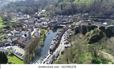 Aerial picture of La Roche en Ardenne and in background two people in kayak moving over Ourth river located in Belgium this town is one of most popular tourist destinations in Ardennes