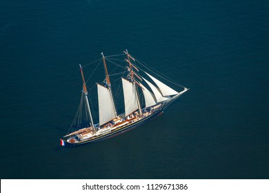 Aerial picture,  large sailboat goes to sea under sail. View from above.