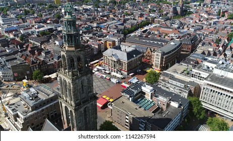 Aerial picture of the Martinitoren also called the St. Martin's Tower is highest church steeple in city of Groningen Netherlands and the bell tower of the Martinikerk als showing Grote Markt