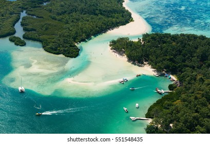 Aerial picture of Mauritius Island. Boat sailing around l'ile aux Cerfs in the beautiful lagoon of Mauritius