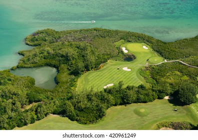 Aerial picture of Mauritius Island. Aerial view of golf course and lagoon in Mauritius