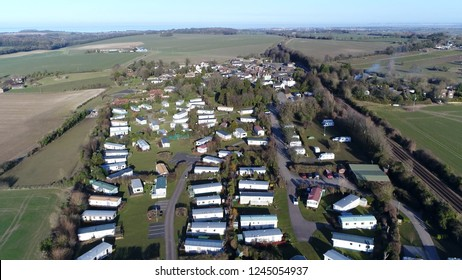 Aerial picture of mobile homes partlty used as permanent houses but aslo for holiday or temporary accommodation they are left often permanently or semi-permanently in one place but can be moved