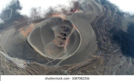 Aerial picture Mount Etna volcanic crater one of the flank craters is roughly circular depression in ground caused by volcanic activity and is typically bowl-shaped feature also showing people walking
