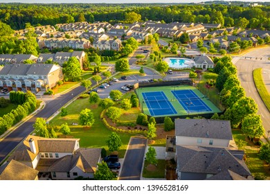 Aerial picture suburban gated community southern united states during sunset