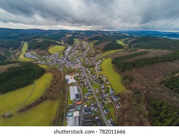 Aerial picture of the village Kirchveischede in the region Sauerland in Germany