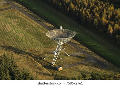 Aerial picture of a Westerbork Synthesis Radio Telescope in Zwiggelte in the provence of Drenthe, The Netherlands. A large shadow is visible because of the low sun in autumn.
