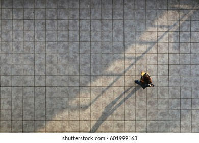 Aerial portrait of young woman with mobile phone on street