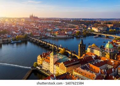 Aerial Prague panoramic drone view of the city of Prague at the Old Town Square, Czechia. Prague Old Town pier architecture and Charles Bridge over Vltava river in Prague at sunset, Czech Republic.