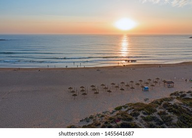 Aerial from Praia do Amado at the west coast in Portugal at sunset