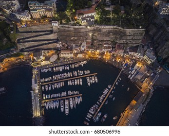 Aerial romantic view of marina full of yachts in the evening.
