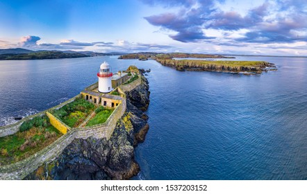Aerial of the Rotten Island Lighthouse with Killybegs in background - County Donegal - Ireland.