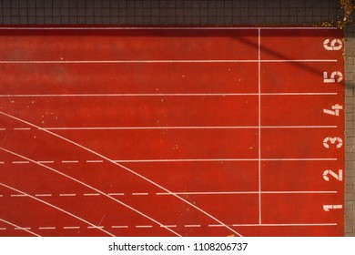 Aerial of running track lanes shot from above