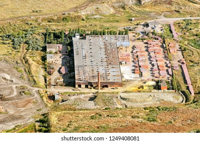 Aerial satellite landscape air drone view of old vintage retro industrial department factory with workshop building manufactory smokestack storage area landmark overview abstract landmark background