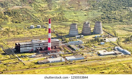 Aerial satellite landscape air drone view of old vintage retro industrial thermal power plant with office department building smokestack railroad landmark overview abstract landmark background