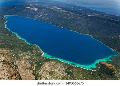 Aerial scene of freshwater Vrana lake (Vransko jezero) on Cres island, Adriatic Sea, Croatia - Shutterstock ID 1490666675