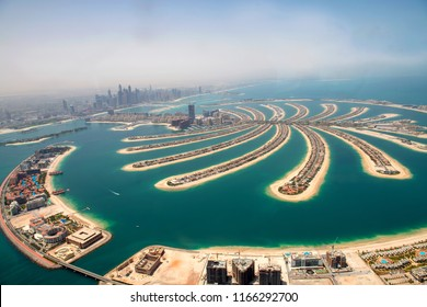 Aerial scene of a man made palm island in Dubai, United Arab Emirates.