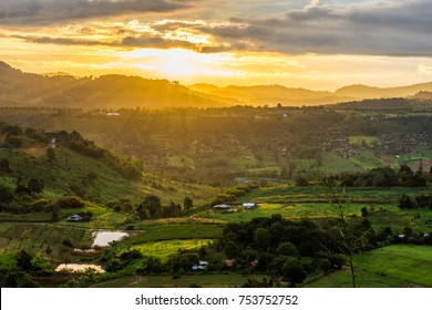 Aerial scenery view of sunrise over mountain range at rural village. Location in Khao Kho District, Phetchabun, Thailand, Southeast Asia.