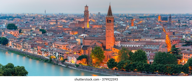 Aerial scenic panorama of Verona skyline with river Adige, Santa Anastasia Church and Torre dei Lamberti or Lamberti Tower at evening, view from Piazzale Castel San Pietro, Italy