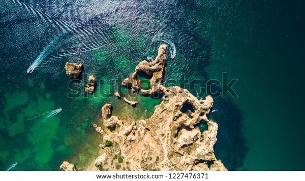 Aerial of Scenic Ponta da Piedade of Lagos, Portugal. Rugged seaside cliffs and aqua ocean waters in the Algarve region of Portugal