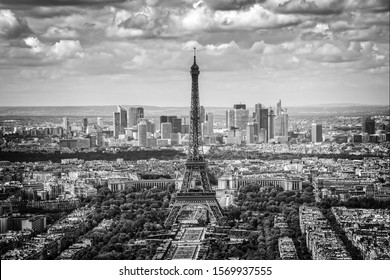 Aerial scenic view of Paris with the Eiffel tower and la Defense business district skyline, black and white