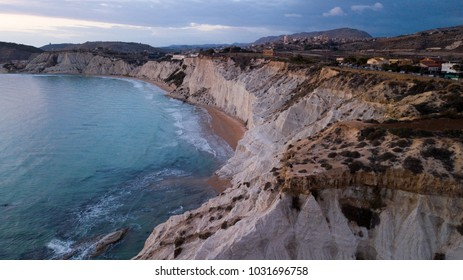 Aerial scenic view of Scala dei Turchi/ Stair of the Turks in Sicily, Italy, Mediterranean Sea and coast. rocky cliff on coast of Realmonte in Sicily Italy has become a popular tourist attraction