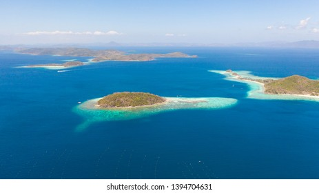 aerial seascape Lagoons with blue, azure water in middle of small islands. Palawan, Philippines. tropical islands with blue lagoons, coral reef. Islands of the Malayan archipelago with turquoise