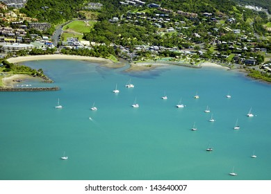 Aerial of seaside town in the Whitsundays, Queensland Australia. Looking down at the main street in Airlie Beach.