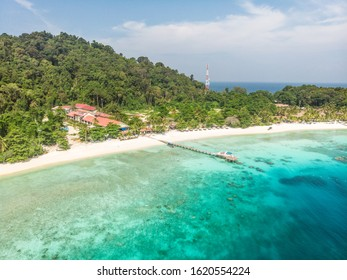 Aerial shoot of the clear blue sea water Pulau Lang Tengah Island in Malaysia