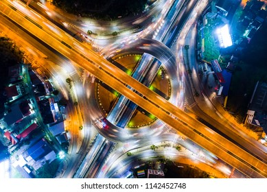 Aerial shoot top view circle road Traffic in city at night, bangkok , thailand.
