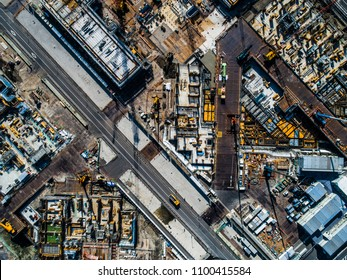 Aerial shooting in the industrial area under development. The view from directly above.
