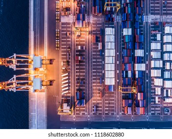 Aerial shooting of a large container ship at night. Viewpoint from directly above.