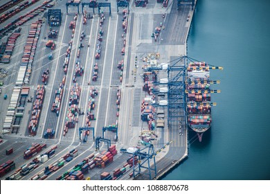 Aerial shooting of large container ships and cranes.