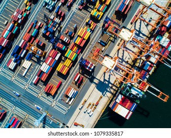 Aerial shooting of loading and unloading containers.