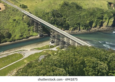 Aerial of Shoreline Highway bridge over water in California, USA.