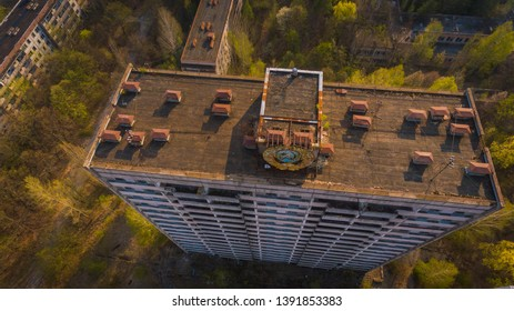 Aerial shot of an abandoned Chernobyl house with Soviet symbol in spring