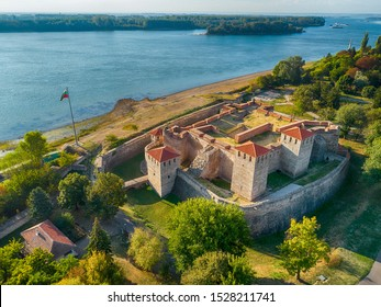 Aerial shot of Baba Vida fortress in Vidin, Bulgaria on the shore of Danube river - impressive and well preserved cultural monument under the golden light of the setting sun