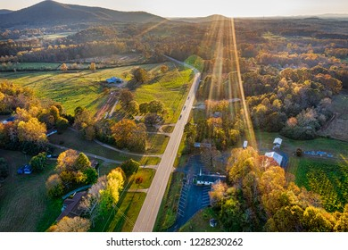 Aerial shot of backlit road in Georgia Mountains during the sunset in the Fall season