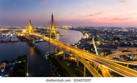 Aerial Shot : beautiful night scene of Bhumibol Bridge, also known as the Industrial Ring Road Bridge, The bridge crosses the Chao Phraya River in Bangkok, Thailand, for transportation concept