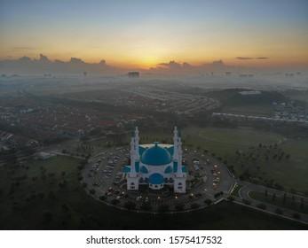 Aerial shot of beautiful Sultan Iskandar Mosque during sunrise or morning. Sultan Iskandar Mosque located at Dato Onn city, Johor Bahru, Malaysia.
