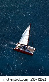 Aerial shot of catamaran from helicopter