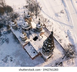 An aerial shot of the Church of the Resurrection of Christ on a sunny winter day in village Ostrov, Yaroslavl Region, Russia - Shutterstock ID 1942761283