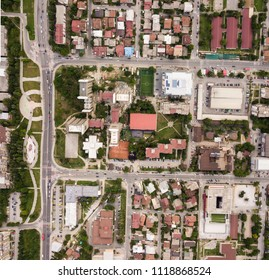 Aerial shot of a city block in a green area . Wide sattelite shot of a town