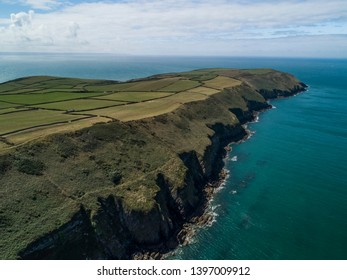 Aerial shot of coastline and cliffs in North Devon, United Kingdom