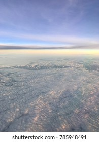 Aerial Shot of Colorful Sunset From Airplane with Cloud Cover