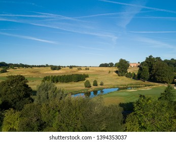 Aerial shot of countryside scenery and golf course in England