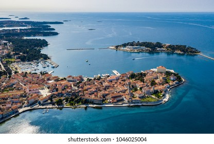 Aerial shot of the Croatian town of Porec. The town of Porec is almost 2,000 years old, and is set around a harbour protected from the sea by the small island of Sveti Nikola.