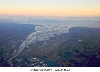 Aerial shot of the Dee estuary and the Wirral, England, UK, evening light.