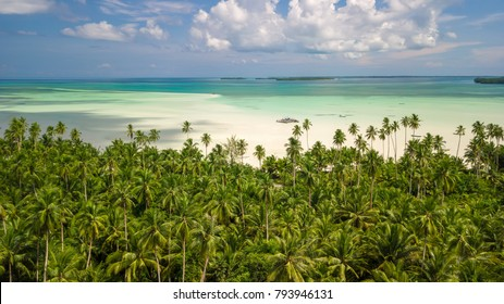 Aerial shot of deserted tropical Ohoidertawun beach with vast area of white sand, Kei Kecil island, Maluku, Indonesia