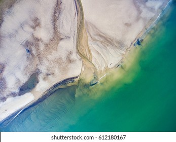 Aerial shot of the Figgate Burn runs into the Firth of Forth (North Sea). Portobello Beach, Edinburgh, Scotland, UK