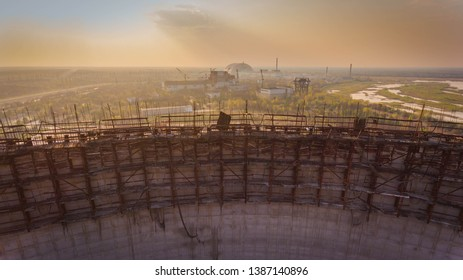 Aerial shot of a giant round structure in Chernobyl with water around